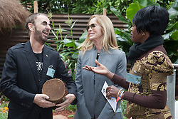 © Licensed to London News Pictures. 21/05/2012. London, England. Ringo Starr, with wife Barbara Bach, receives a drum from Malawi as a present at the Herbert Smith Garden for WaterAid. RHS Celsea Flower Show 2012 - Press Day. Photo credit: Bettina Strenske/LNP