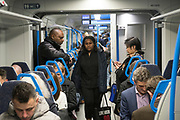 Commuters. London overland railway system and underground trains.