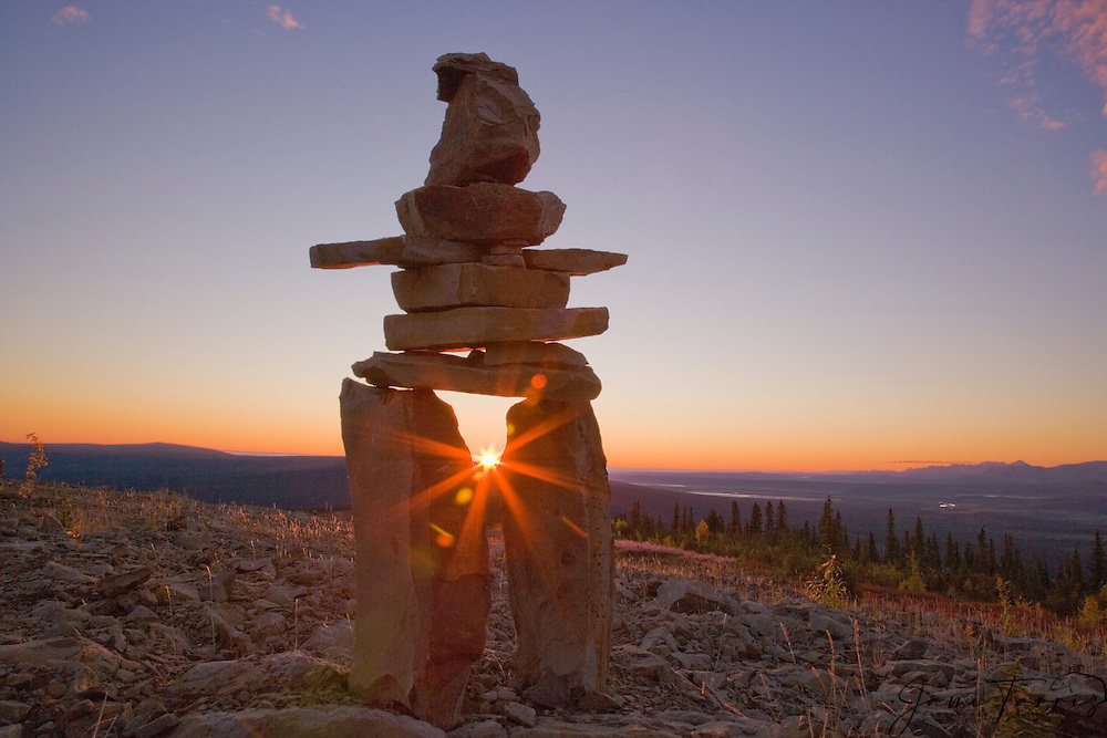 """The Inukshuk, meaning """"image of man"""" is a lifelike figure of stone which was erected by the Inuit people and are unique to the Canadian Arctic. They act as a compass or guide through the wilderness for a safe journey and represent safety, trust and reassurance, Northwest Territory, Canada"""