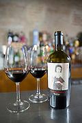 Glasses and bottle of red wine of El Canto de la Alondra, ribera del Duero wine in a bar by River Duero, Navarro, Spain