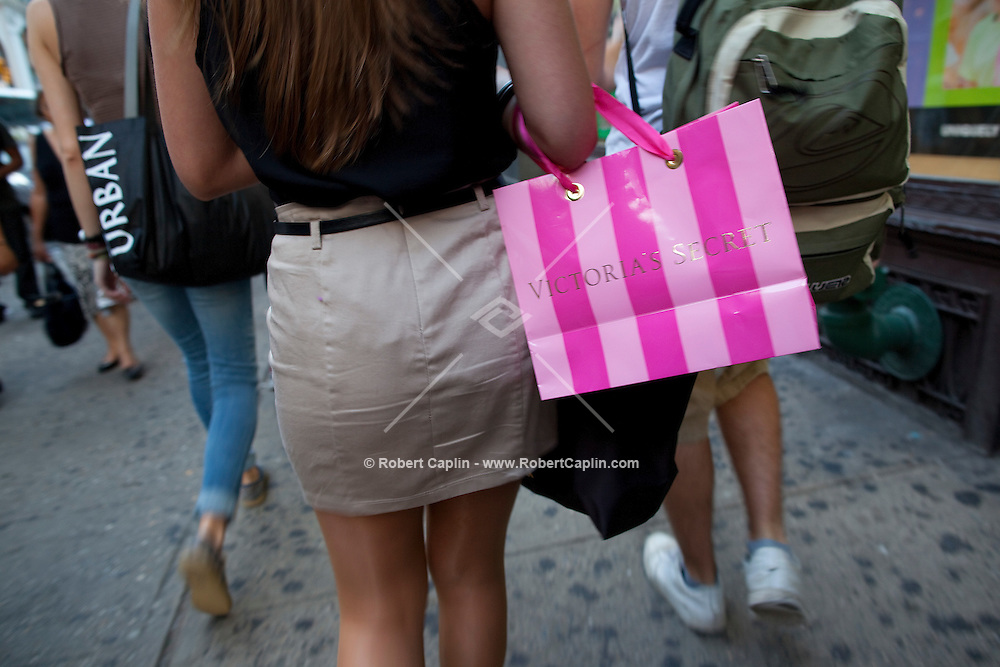 Shopping bags in SoHo, downtown New York. ..Photo by Robert Caplin.