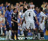 Photo: Lee Earle.<br /> Chelsea v Bolton Wanderers. The Barclays Premiership.<br /> 15/10/2005.ref Rob Styles shows the red card to Bolton's Ricardo Gardner.