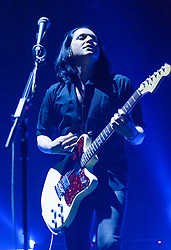 © Licensed to London News Pictures. 16/12/2013. London, UK.   Placebo performing live at Brixton Academy. In this picture - Brian Molko.  Placebo are an English alternative rock band, formed in London in 1994, consisting of members Brian Molko (lead vocals/guitars), Stefan Olsdal (vocals/bass), Steve Forrest (drums/vocals).  The band is touring to support its seventh studio album 'Loud Like Love'. Photo credit : Richard Isaac/LNP