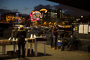 People at the second hand book stalls on the riverside walkway as dusk turns to evening on the Southbank, London, United Kingdom. The South Bank is a significant arts and entertainment district, and home to an endless list of activities for Londoners, visitors and tourists alike. (photo by Mike Kemp/In Pictures via Getty Images)