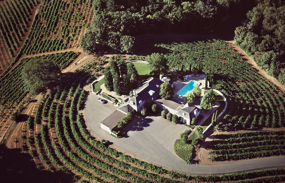 Aerial of home in St Helena, California with gardens designed by Thomas Church. House and garden surrounded by vineyards.