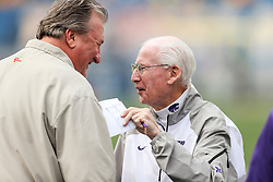 Sep 22, 2018; Morgantown, WV, USA; Kansas State Wildcats head coach Bill Snyder talks with West Virginia Mountaineers head basketball coach Bob Huggins before the game at Mountaineer Field at Milan Puskar Stadium. Mandatory Credit: Ben Queen-USA TODAY Sports