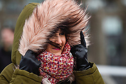© Licensed to London News Pictures. 09/02/2020. LONDON, UK.  A woman braves the elements on Millennium Bridge as Storm Ciara brings strong winds and rain to much of the UK.  The Met Office has issued yellow and amber warnings for the country.  Photo credit: Stephen Chung/LNP