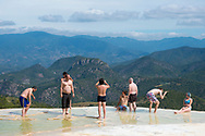 Tourists experience the dramatic scenery at Hierve el Agua in Oaxaca State, Mexico
