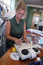 Woman using minicom with printer,