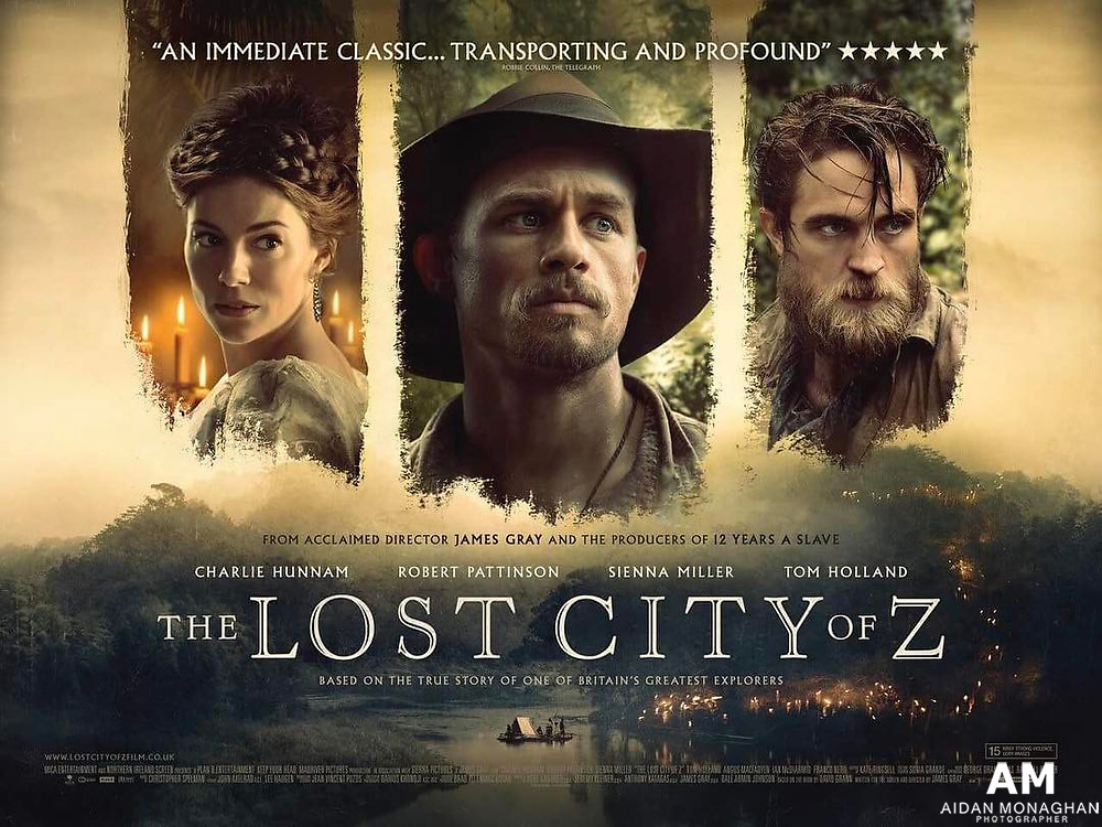 """The Lost City of Z is based on the book by David Grann, the film is directed by James Gray and stars Charlie Hunnam as British explorer Percy Fawcett. The film also stars Robert Pattinson, Sienna Miller, and Tom Holland.<br /> <br /> Based on author David Grann's nonfiction bestseller, THE LOST CITY OF Z tells the incredible true story of British explorer Percy Fawcett (Charlie Hunnam), who journeys into the Amazon at the dawn of the 20th century and discovers evidence of a previously unknown, advanced civilization that may have once inhabited the region. Despite being ridiculed by the scientific establishment who regard indigenous populations as """"savages,"""" the determined Fawcett – supported by his devoted wife (Sienna Miller), son (Tom Holland) and aide-de-camp (Robert Pattinson) – returns time and again to his beloved jungle in an attempt to prove his case, culminating in his mysterious disappearance in 1925. An epically scaled tale of courage and obsession, told in James Gray's classic filmmaking style, THE LOST CITY OF Z is a stirring tribute to the exploratory spirit and those individuals driven to achieve greatness at any cost."""