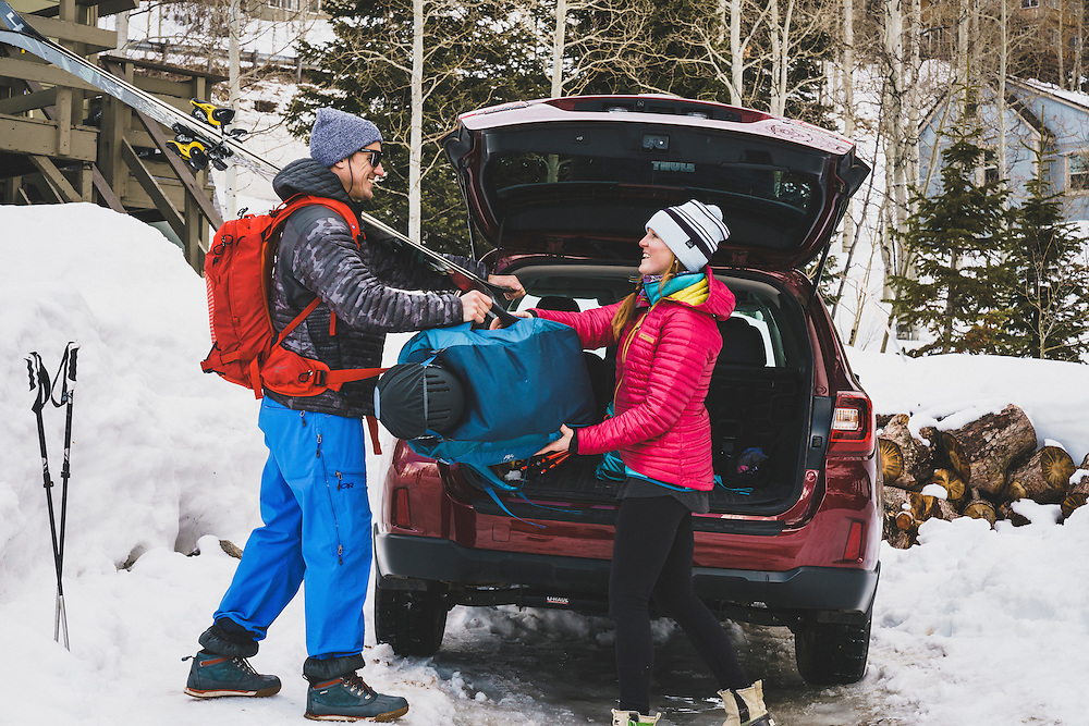 Rob Aseltine and Mali Noyes load the car for a day of skiing, Brighton, Utah.