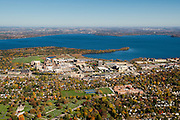 An aerial view of Madison, Wisconsin,  the UW Hospital and VA Hospital complex, surrounded by Lakes Mendota (above) and Picnic Point, and Madison West High School in the lower right.