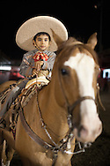 October 1st, 2011. Pico Rivera, California. Traditional charros (Mexican cowboys) compete in a Mexican Rodeo. The competition at the Pico Rivera Sports Arena is a display of horsemanship and lasso skills. Pictured is Alamillo Family, Martin (42), Martin Jr (11), Julian Jacob (5) and Susana (34)..PHOTO © JOHN CHAPPLE / www.johnchapple.com