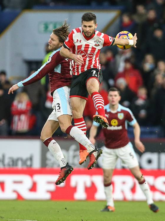 Burnley's Jeff Hendrick jumps for a header with Southampton's Shane Long<br /> <br /> Photographer Alex Dodd/CameraSport<br /> <br /> The Premier League - Burnley v Southampton - Saturday 14th January 2017 - Turf Moor - Burnley<br /> <br /> World Copyright © 2017 CameraSport. All rights reserved. 43 Linden Ave. Countesthorpe. Leicester. England. LE8 5PG - Tel: +44 (0) 116 277 4147 - admin@camerasport.com - www.camerasport.com
