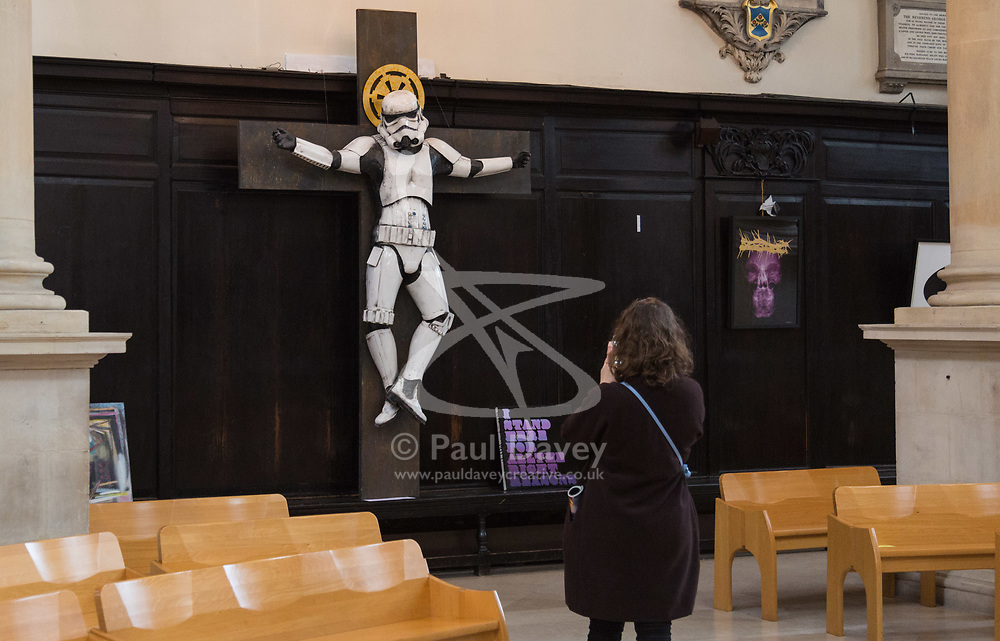 """A controversial sculpture of a Star Wars Stormtrooper crucifix is to be removed from St.Stephen Walbrook church in the City of London, following complaints by the church's parishioners. The artwork is the creation of Ryan Callanan, an artist whose street artist pseudonym is RYCA. Church authorities have asked for the £12,000 piece to be removed by 4pm on Tuesday March 13th. St.Stephen Walbrook is hosting Art Below's 'Stations of the Cross' exhibition which opens on March 14th. The exhibition is """"...designed to provoke thought from artists grappling with their response to the challenge and scandal of Christ's cross"""". London, March 13 2018."""