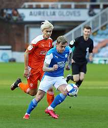 Sammie Szmodics of Peterborough United in action with Kenny Dougall of Blackpool - Mandatory by-line: Joe Dent/JMP - 21/11/2020 - FOOTBALL - Weston Homes Stadium - Peterborough, England - Peterborough United v Blackpool - Sky Bet League One