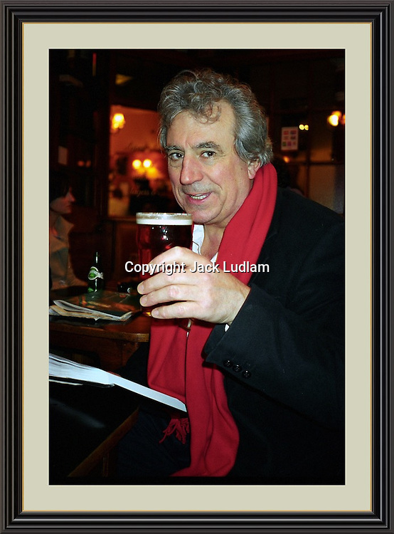 Terry Jones having a Pint in Sohos Coach & Horses<br /> Museum-quality Archival Large signed Framed Photograph