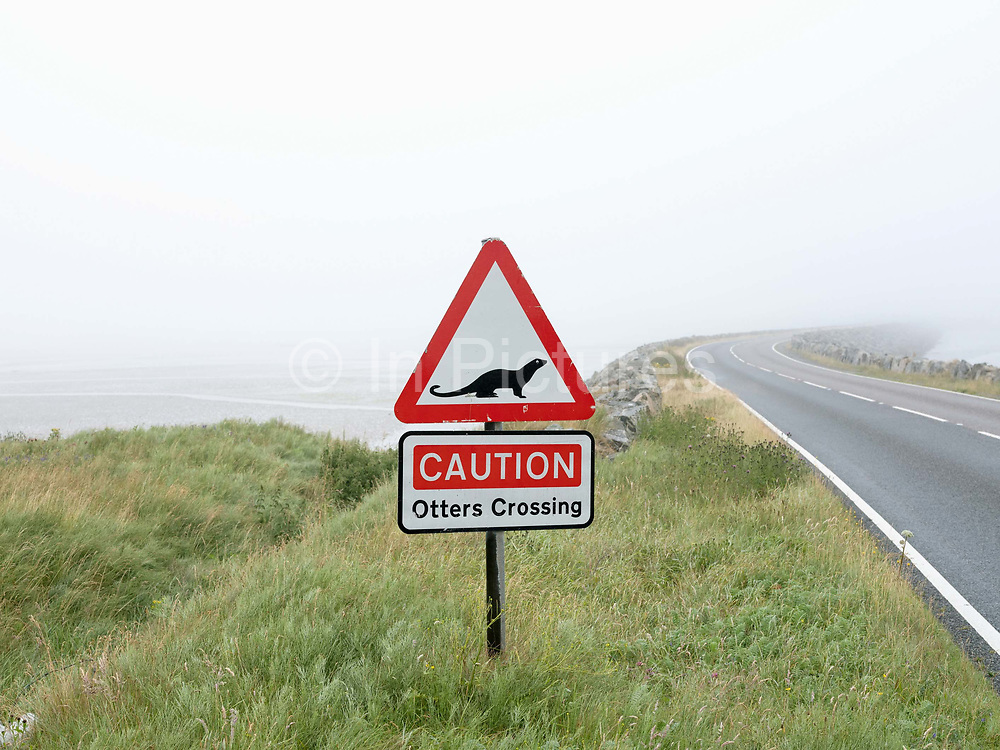 Otters crossing sign on the causeway between Benbecula and South Uist, Outer Hebrides, Scotland on 21 July 2018
