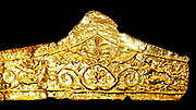 Gold pediment-shaped diadems 330-300BC. These diadems are made of thin sheet gold with die-formed designs.  The most elaborate of them has a central palmette and winged figures on either side with scroll work beyond.  The Kyme Treasure contained fragments of at least 11 such diadems; they were probably especially made for the tomb.