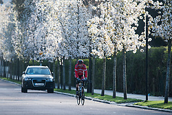 © Licensed to London News Pictures. 29/03/2020. London, UK. A man cycling around Regents Park, London in the early morning sun, during a lockdown over the Coronavirus spread. Members of the public have been told they can only leave their homes to exercise briefly once a day, and to go to shops for essentials when absolutely necessary, in an attempt to fight the spread of COVID-19. Photo credit: Ben Cawthra/LNP