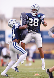July 28, 2018 - Oxnard, CA, U.S. - OXNARD, CA - JULY 28: Dallas Cowboys cornerback Chidobe Awuzie (24) runs drills with Dallas Cowboys defensive back Jameill Showers (28) during the Dallas Cowboys Training Camp on July 28, 2018, at River Ridge Playing Fields in Oxnard, CA. (Photo by David Dennis/Icon Sportswire) (Credit Image: © David Dennis/Icon SMI via ZUMA Press)