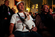 MORENA's supporter with a chihuaua supporter.  AMLO has 25% of preferences more than other parties. Watching the debate in big screen.<br /> AMLO is the only hope of the low class.