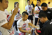 """Dae Hwan Kim, Kamma Bantam weight champion, getting hands bandaged in locker room before fight<br /><br />MMA. Mixed Martial Arts """"Tigers of Asia"""" cage fighting competition. Top professional male and female fighters from across Asia, Russia, Australia, Malaysia, Japan and the Philippines come together to fight. This tournament takes place in front of a ten thousand strong crowd of supporters in Pelaing Stadium. Kuala Lumpur, Malaysia. October 2015"""