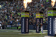 Aug 25, 2017; Seattle, WA, USA; Seattle Seahawks quarterback Russell Wilson (3) runs onto the field through flames during a NFL football game against the Kansas City Chiefs at CenturyLink Field.