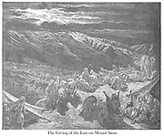 The Giving of the Law Upon Mt. Sinai Exodus 19:18 From the book 'Bible Gallery' Illustrated by Gustave Dore with Memoir of Dore and Descriptive Letter-press by Talbot W. Chambers D.D. Published by Cassell & Company Limited in London and simultaneously by Mame in Tours, France in 1866