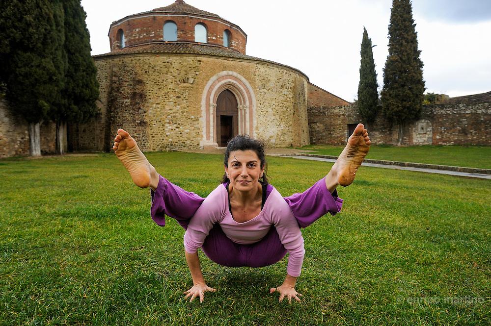 Perugia. Carla Ricci, yoga teacher, near St Angelo church that, with his circular architecture, reminds a buddhist stupa.