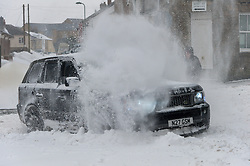 © Licensed to London News Pictures. 2/03/2018. Brynmawr, Blaenau Gwent,, South Wales, UK. A large fou X four vehicle powers through deep snow. People battlle against the blizzard, snowdrifts and horrendous weather conditions as Storm Emma continues without mercy at Brynmawr in South Wales (the highest town in Wales.)  Photo credit: Graham M. Lawrence/LNP