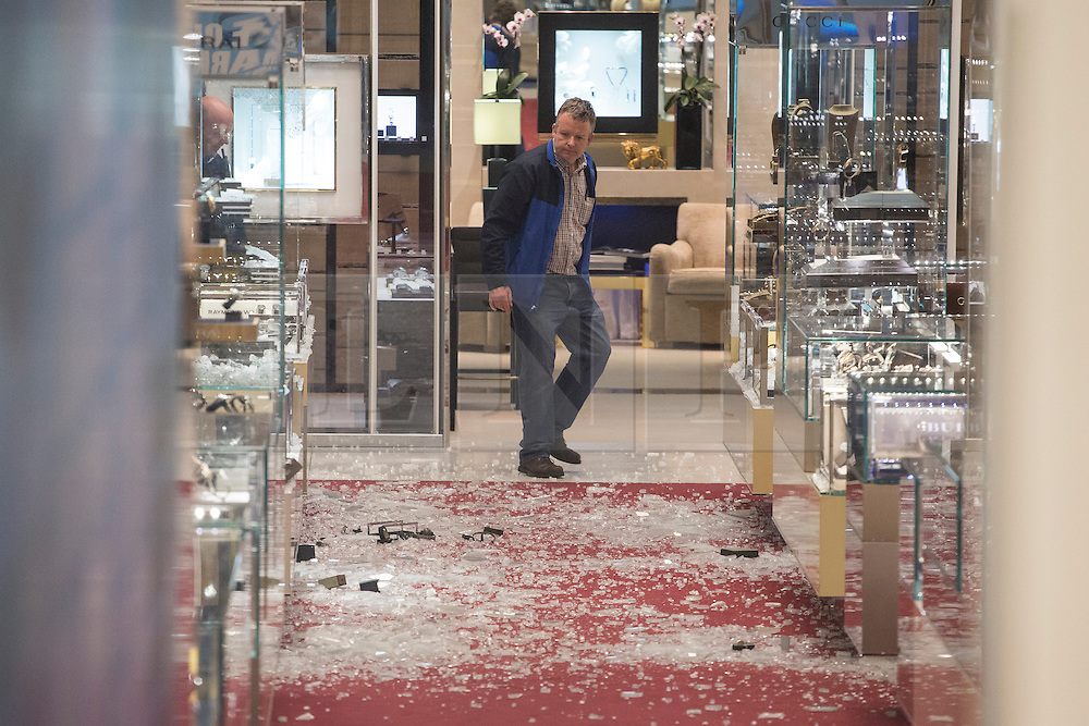 © licensed to London News Pictures. London, UK 06/06/2013. A man looking at the damage left after an armed robbery at Selfridges on Oxford Street, London. Photo credit: Tolga Akmen/LNP
