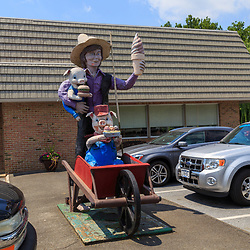 Ronks, PA - July 23, 2016: Katies is an Amish-owned and operated restaurant that includes a statue of an Amish boy holding an ice cream cone and two pigs.