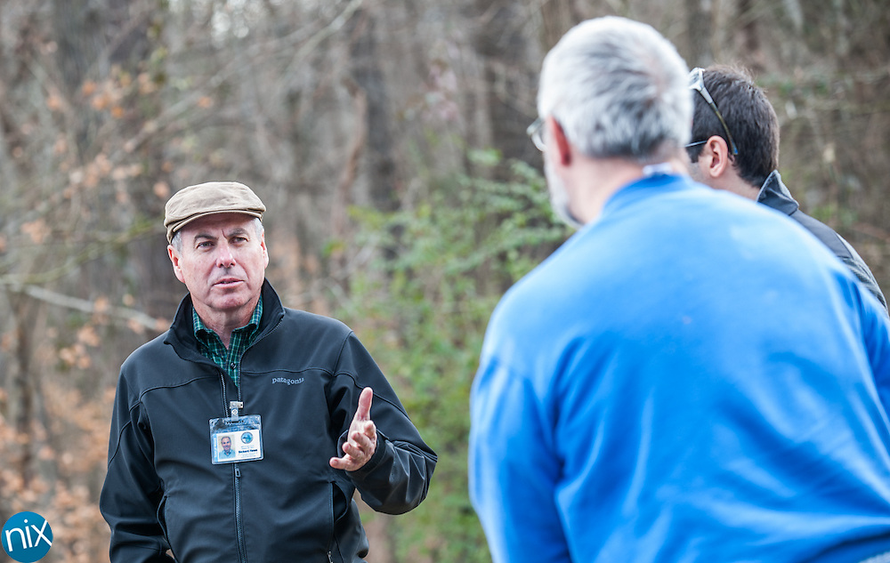 Midland town planner Richard Flowe and town administrator David Pugh talk to a resident Steven Stillwell about a new sewer line that will be installed near his property.