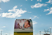 Bolivia June 2013. Decorated back of bus featuring Angel and child against a blue sky with a few scudding clouds.