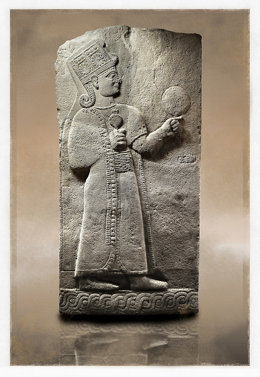 Picture & image of a Neo-Hittite orthostat showing a releif sculpture  of the Goddess Kubaba from Karkamis,, Turkey. Museum of Anatolian Civilisations, Ankara. 2 In her right hand she is holding a pomegranate