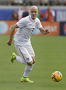 JACKSONVILLE, FL - JUNE 07:  Michael Bradley #4 of the United States dribbles during the international friendly match against Nigeria at EverBank Field on June 7, 2014 in Jacksonville, Florida.  (Photo by Mike Zarrilli/Getty Images)