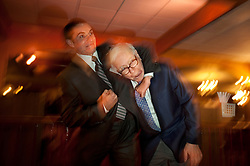 Warren Buffett poses with business students from universities around the country after at lunch at Piccolo Pete's Restaurant in Omaha, Neb., Nov. 11, 2011. Here, Buffett poses with David Lorenz of Northern Arizona University.