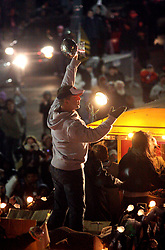 09 February 2010. New Orleans, Louisiana, USA. <br /> Sean Payton holds the coveted Lombardi trophy aloft as he leads the team along Canal Street. Saints Mania captures New Orleans like no other parade. The New Orleans Saints victorous NFL football team makes its way from the Superdome through the city. The team salutes the massed crowds along the victory parade route in downtown New Orleans following the team's stunning victory over the Indianapolis Colts for Superbowl 44. <br /> Photo ©; Charlie Varley. Varleypix.com