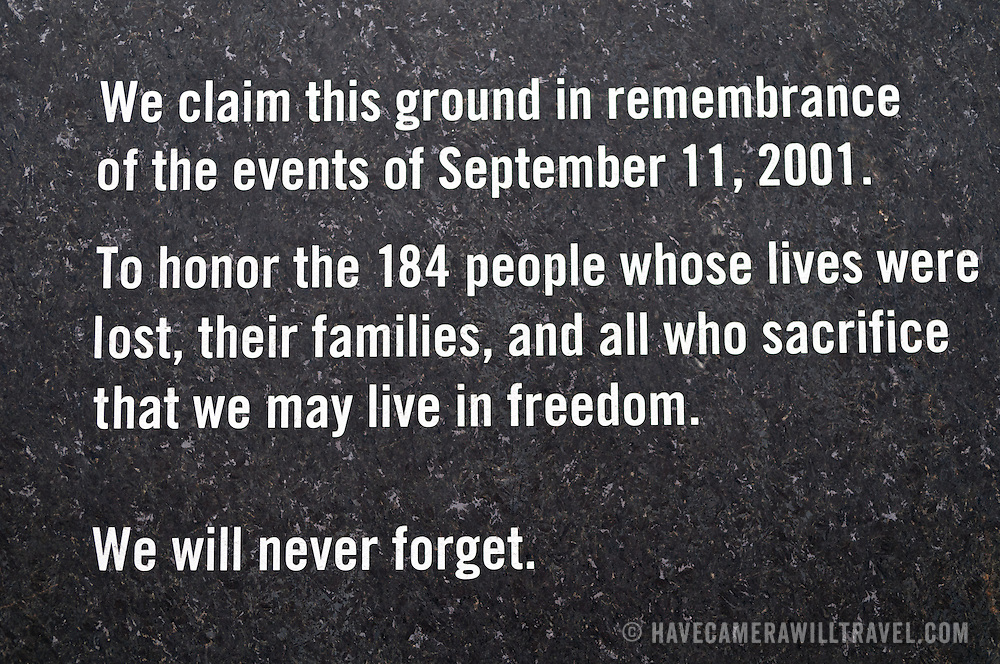 Dedication sign at the Pentagon Memorial. The Pentagon Memorial is in remembrance of the events of September 11, 2001, and the 184 people who died as victims of the terrorist attack on the Pentagon. The Memorial is adjacent to the southwest side of the Pentagon. Designed by Julie Beckman and Keith Kaseman, the memorial opened to the public on September 11, 2008, it is designed with one illuminated for each victim of the attack, arranged by the person's age. Each bench has a small pond of water underneath, and a name is etched on the end of each bench.