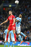 Jordan Henderson of Liverpool (l) and Raheem Sterling of Manchester City jump for the ball. Capital One Cup Final, Liverpool v Manchester City at Wembley stadium in London, England on Sunday 28th Feb 2016. pic by Chris Stading, Andrew Orchard sports photography.
