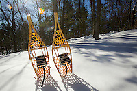traditional snowshoes propped in fresh snow