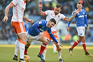 Blackpool Midfielder, Jay Spearing (44) fouls Portsmouth Forward, Conor Chaplin (19) during the EFL Sky Bet League 1 match between Portsmouth and Blackpool at Fratton Park, Portsmouth, England on 24 February 2018. Picture by Adam Rivers.