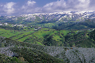 Snow storm in spring dusting green rolling hills of rural Santa Clara County, California