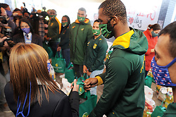 South Africa - Cape Town - 25 June 2020 - Springbok captain Siya Kolisi, fellow RWC-winners Herschel Jantjies and Damian Willemse, Blitzboks skipper Siviwe Soyizwapi, Springbok Women's Sevens captain Zintle Mpupha, SA Rugby Management and new sponsor Engen accompanied Gift of the Givers teams at a distribution to learners of Peakview Secondary School, Athlone, Cape Town, today. Gift of the Givers established a borehole at the school during the height of the drought in 2018. Food parcels, hygiene and stationery packs, blankets from TFG, bulk food for the school feeding scheme and fortified nutritional products werehanded out.. Photographer: Armand Hough/African News Agency(ANA)