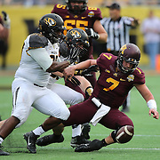 ORLANDO, FL - JANUARY 01: Mitch Leidner #7 of the Minnesota Golden Gophers  fumbles the football during the Buffalo Wild Wings Citrus Bowl against the Missouri Tigers at the Florida Citrus Bowl on January 1, 2015 in Orlando, Florida. (Photo by Alex Menendez/Getty Images) *** Local Caption *** Mitch Leidner