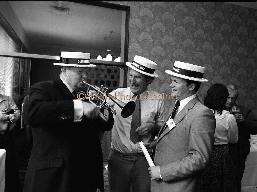 """Guinness Jazz Festival, Cork.01/07/1982.Topping the bill at the festival were,The First Lady of Jazz, """"Ella Fitzgerald"""",The legendary """"B.B.King"""" and the unique """"Modern Jazz Quartet""""..At the reception Mr Bobby Howick, Trade Director Guinness Group Sales, tries out the trumpet of Mr Pieter Sluis (centre)..Mr Sluis is a member of The Bruxelles Jazz Group,who played at the reception. Also pictured is Mr Jim Mountjoy, Metropole Hotel, Cork. Mr Mountjoy is a Co-festival Director."""