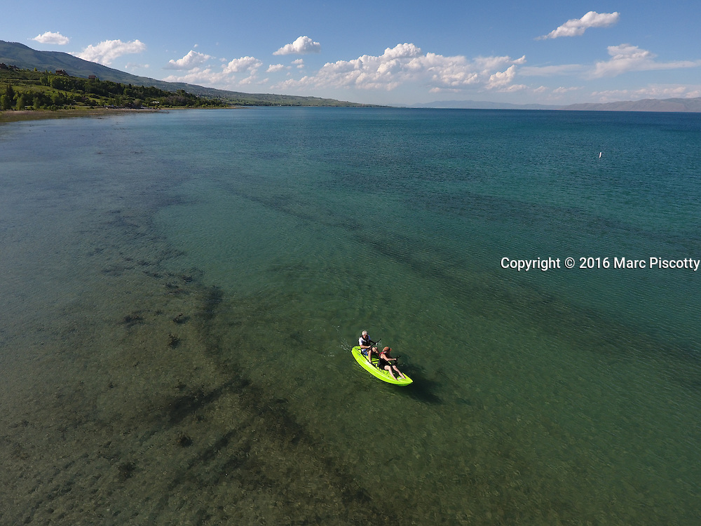 """SHOT 6/9/16 5:42:58 PM - Bear Lake is a natural freshwater lake on the Utah-Idaho border in the Western United States. About 109 square miles in size, it is split about equally between the two states. The lake has been called the """"Caribbean of the Rockies"""" for its unique turquoise-blue color, which is due to the reflection of calcium carbonate (limestone) deposits suspended in the lake. The lake is a popular destination for tourists and sports enthusiasts, and the surrounding valley has gained a reputation for having high-quality raspberries. (Photo by Marc Piscotty / © 2016)"""