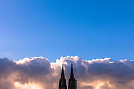cloud bank and the steeples of the cathedral, Cologne, Germany.<br /> <br /> Wolkenbank und Turmspitzen des Doms, Koeln, Deutschland.
