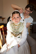 Preparing the hair of the Sorbian Druschkas.<br /> <br /> Traditional Dressing Lady Kristin; <br /> Druschka 1: Saskia<br /> Druschka 2: Louisa<br /> Girl 3: Julia<br /> Dressing Lady: Kristin<br /> <br /> The catholic holiday of Corpus Chisiti is a much celebrated tradition among the catholic Sorbian Minority. Dozens of Druschkas in traditional costume walk with Germans, Ministrants and residents of Wittichenau in groups through town, singing and praying. Two processions, one in the morning and one in the afternoon, follow devotions and prayers through the streets that are adorned with birch trees.<br /> <br /> Wittichenau, Saxony, May 31, 2018.